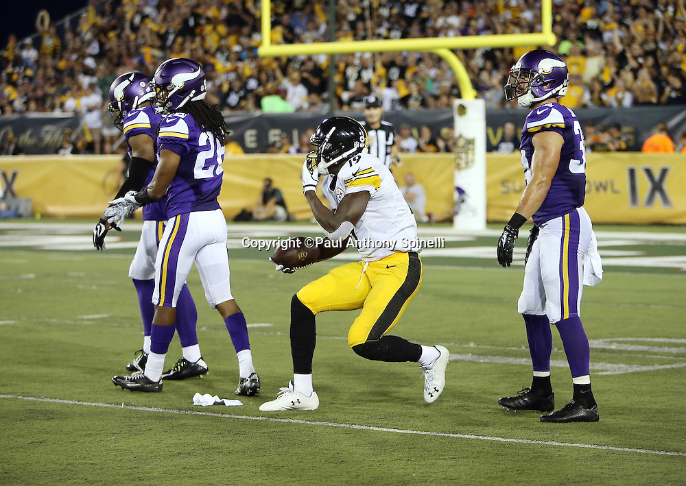 Pittsburgh Steelers rookie wide receiver Shakim Phillips (19) is surrounded by Minnesota Vikings defenders after catching a second quarter for a first down in the red zone during the 2015 NFL Pro Football Hall of Fame preseason football game against the Minnesota Vikings on Sunday, Aug. 9, 2015 in Canton, Ohio. The Vikings won the game 14-3. (©Paul Anthony Spinelli)