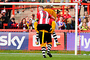 Pierce Sweeney (2) of Exeter City gets a piggyback ride from Exeter club mascot Grecian the Lion at full time to celebrate the 1-0 win over Lincoln City during the EFL Sky Bet League 2 match between Exeter City and Lincoln City at St James' Park, Exeter, England on 19 August 2017. Photo by Graham Hunt.
