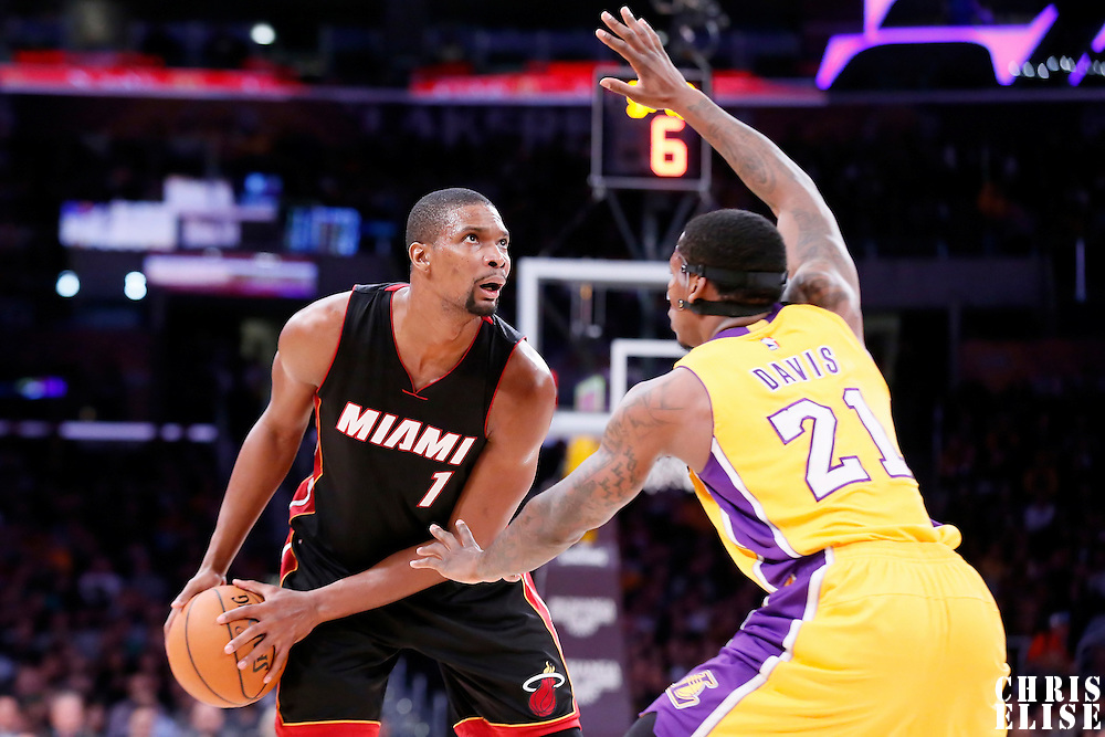 13 January 2014: Los Angeles Lakers forward Ed Davis (21) defends on Miami Heat center Chris Bosh (1) during the Miami Heat 78-75 victory over the Los Angeles Lakers, at the Staples Center, Los Angeles, California, USA.