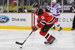 Jan 31; Newark, NJ, USA; New Jersey Devils defenseman Andy Greene (6) skates with the puck during the first period of their game against the New York Rangers at the Prudential Center.