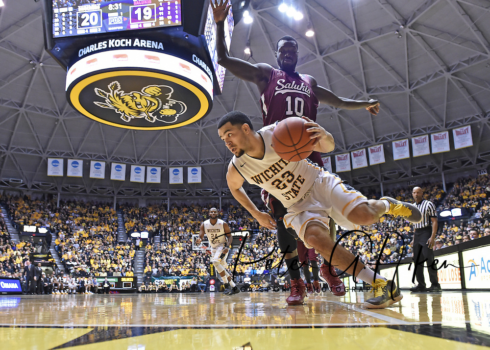 Guard Fred VanVleet #23 of the Wichita State Shockers drives around center Ibby Djimde #10 of the Southern Illinois Salukis during the first half at Charles Koch Arena in Wichita, Kansas.