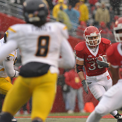 Dec 5, 2009; Piscataway, NJ, USA; Rutgers running back Joe Martinek (38) runs the ball during second half NCAA Big East college football action in West Virginia's 24-21 victory over Rutgers at Rutgers Stadium.