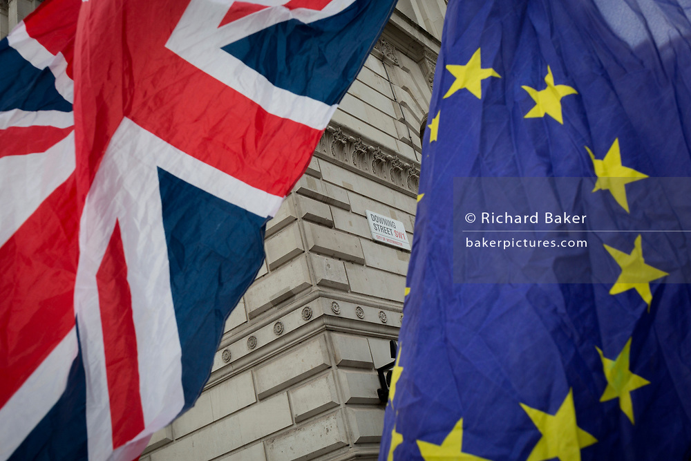As the EU's Chief negotiator Michel Barnier meets Theresa May in London to discuss the next stage of Brexit, the Union jack and the stars of the EU flag belonging to to anti-Brexiter flies in Whitehall and the corner of Downing Street, the official residence of the Prime Minister, on 5th February 2018, in London England.