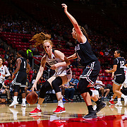 09 November 2018: San Diego State Aztecs center Zayn Dornstauder (22) drives the ball into the key against Hawaii Warriors center Lauren Rewers (14) in the second quarter. The Aztecs opened up it's regular season schedule with a 58-57 win over Hawaii Friday at Viejas Arena.