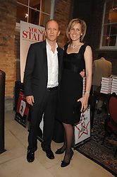 SIMON & SANTA SEBAG-MONTEFIORE  at a party to celebrate the publication of 'Young Stalin' by Simon Sebag-Montefiore at Asprey, New Bond Street, London on 14th May 2007.<br /><br />NON EXCLUSIVE - WORLD RIGHTS