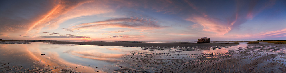On the first day of fall, the sun sets at low tide at Dyer Prince Beach in Eastham.