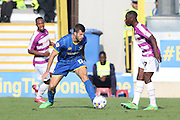 Jon Meades of AFC Wimbledon and Andy Yiadom during the Sky Bet League 2 match between AFC Wimbledon and Barnet at the Cherry Red Records Stadium, Kingston, England on 3 October 2015. Photo by Stuart Butcher.
