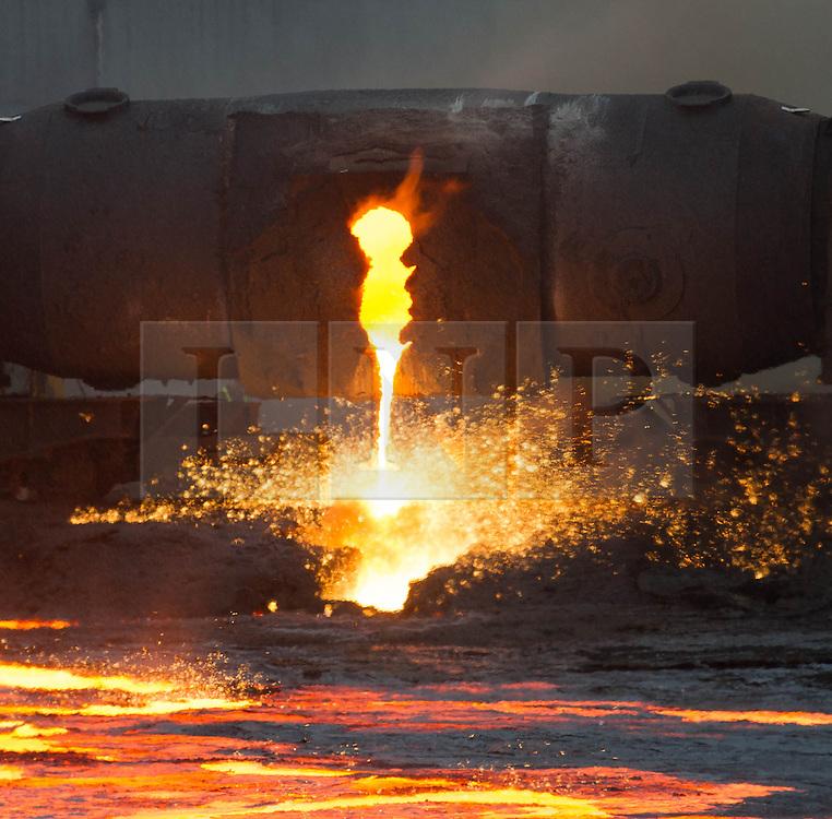 © Licensed to London News Pictures. 28/03/2014<br /> <br /> South Gare, Teesside, United Kingdom<br /> <br /> Torpedo number 43 ponds steel at the Sahaviriya Steel Industries manufacturing site on Teesside.<br /> <br /> Photo credit : Ian Forsyth/LNP