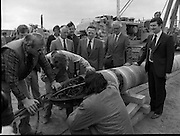Cork / Dublin Gas Pipeline.28.04.1982.04.28.1982.28th April 1982.1982...At Brownbarn,Kingswood,Dublin the Minister for Industry and Energy, Mr Albert Reynolds T.D. performed the ceremonial first weld to officially start the project. .Mr Michael McStay and some other V.I.P's look on as an Internal pipe welder is inspected before insertion into the pipe section.