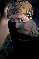 Morocco, Marrakesh. Portrait of a woman wearing a veil.