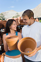 Couple Buying Clay Pots for Plants
