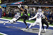 Dallas Cowboys cornerback Chidobe Awuzie (24) and New Orleans Saints rookie wide receiver Tre'Quan Smith (10) look on as New Orleans Saints rookie wide receiver Keith Kirkwood (18) catches a 30 yard touchdown pass that cuts the Cowboys third quarter lead to 13-10 while covered by Dallas Cowboys cornerback Anthony Brown (30) during the NFL week 13 regular season football game against the Dallas Cowboys on Thursday, Nov. 29, 2018 in Arlington, Tex. The Cowboys won the game 13-10. (©Paul Anthony Spinelli)