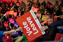 © London News Pictures. 15/04/2016. Manchester, UK. Campaigners pass signs across the audience at a Vote Leave campaign event in Manchester, attended by Boris Johnson, ahead of a referendum on Britain's membership of the EU on June 23rd, 2016.. Photo credit: Ben Cawthra/LNP