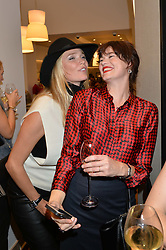Left to right, JODIE KIDD and JASMINE GUINNESS at a party to celebrate the re-opening of the Jaeger Chelsea Store in association with the NSPCC at 145 Kings Road, London on 24th September 2014.