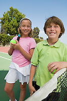 Brother and Sister at Tennis Net
