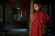 A young monk in Mandalay, Myanmar (Burma) at his monastery.