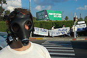 Israel, Haifa bay, A man wearing a gas mask at a protest against air pollution
