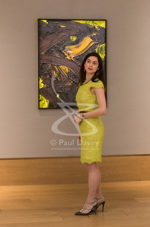 Bonhams, London, March 6th 2017. Fine art auctioneers Bonhams hold a preview in London  for their upcoming Post-War and Contemporary Art Sale which takes place on March 8th 2017. PICTURED: A woman stands in front of  Kazuo Shiraga's 'Sei' valued at between £500,000 and £700,000.
