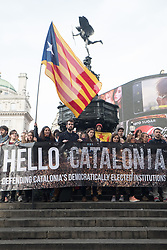 © Licensed to London News Pictures. 28/10/2017. Demonstrators protest in London's Piccadilly Circus against Spanish repression and authoritarianism during and after the referendum vote in Catalonia and to recognise the Republic of Catalonia. London, UK. Photo credit: Ray Tang/LNP