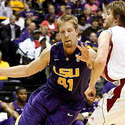November 12, 2011; Baton Rouge, LA; LSU Tigers center Justin Hamilton (41) drives past Nicholls State Colonels guard/forward Chris Talkington (11) during the second half of a game at the Pete Maravich Assembly Center. LSU defeated Nicholls State 96-74.  Mandatory Credit: Derick E. Hingle-US PRESSWIRE