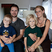 Linköping, Sweden, August 19, 2012. Stolplyckan, the second biggest collective in Sweden with 184 apartments. Sofia, who has been living in Stolplyckan for many years, with her partner and their two kids, Adrian and Elias.