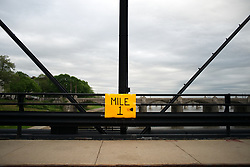 One-mile marker intended for a leisure run is mounted on Walnut St. Bridge, over the Susquehanna River, in Harrisburg, PA, on April 30, 2017. Diminishing retail, crumbling infrastructure, environmental issues, poverty and unemployment are shown in a view on the current state of a section of rural America on day 101 of Trump's Presidency. The Keystone state Pennsylvania formed an important factor in Trump's victory in the 2016 US elections.