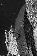 New York , 57 street. the Solow building,  the crown building reflected on the mirror tower