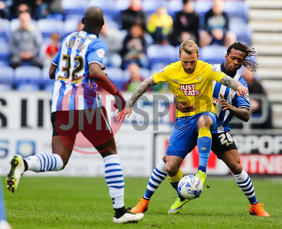 Johnny Russell of Derby County controls the ball under pressure from Gaetan Bong of Wigan Athletic  - Photo mandatory by-line: Matt McNulty/JMP - Mobile: 07966 386802 - 06/04/2015 - SPORT - Football - Wigan - DW Stadium - Wigan Athletic v Derby County - SkyBet Championship