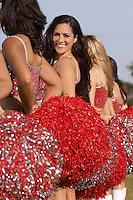 Cheerleaders in row looking over shoulder