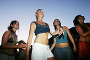 Four cute hippy girls dancing, Sunset beach party, Benirras Beach, Ibiza, July 2006