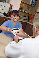 Nurse and doctor doing paperwork in doctor's office