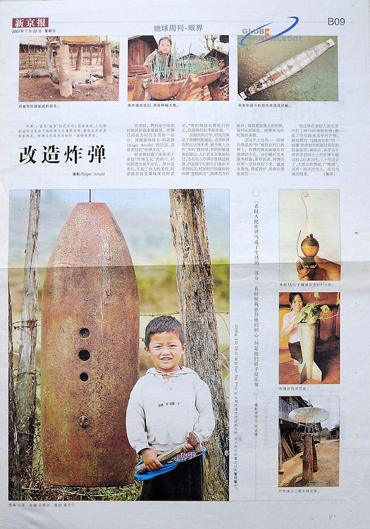 "The Beijing News - page featuring US weapons converted to other uses like planters, boats and satelite dishes.   The USA dropped more than 2 million tons of bombs on Laos during the ""Secret War"" in Laos, which was waged as part of America's involvement in Vietnam.  The large picture is of a boy with a hammer standing next to a bomb bell used to call meetings in his village in Xieng Khouang Province.  The bomb bell is made from a US 750 lb Mk-117 bomb."