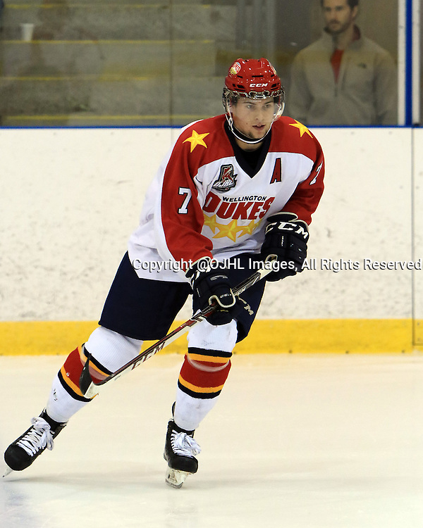 KINGSTON, ON - Sep 17, 2015 : Ontario Junior Hockey League game action between Wellington and Kingston, Luc Brown #7 of the Wellington Dukes during the pre-game warmup<br /> (Photo by Ed McPherson / OJHL Images)