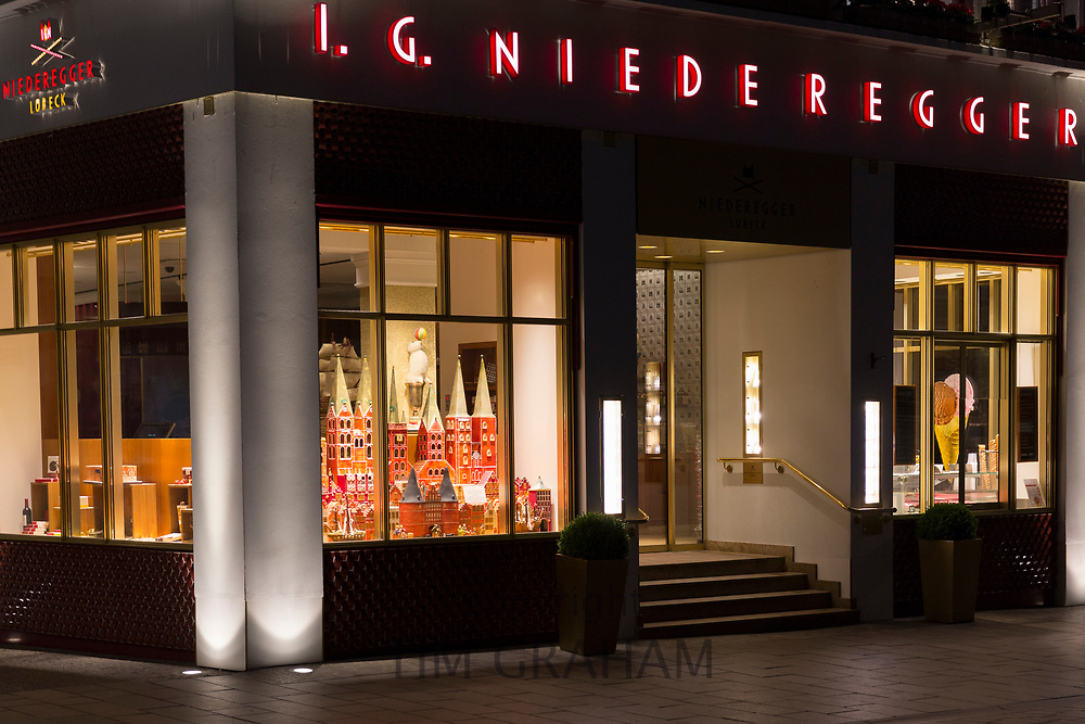 Exterior and shop window display at J.G. Niederegger famous marzipan candy shop in Lubeck, Germany