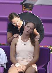 DOHA, Feb. 12, 2018  Daria Kasatkina (Front) of Russia receives medical treatment during the single's first round match against Catherine Bellis of the United States at the 2018 WTA Qatar Open in Doha, Qatar, on Feb. 12, 2018. Daria Kasatkina retired due to injury. (Credit Image: © Nikku/Xinhua via ZUMA Wire)