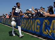 Aug 6, 2018; Costa Mesa, CA, USA: Los Angeles Chargers defensive end Whitney Richardson (90) is greeted by fans during training camp at the Jack. R. Hammett Sports Complex.