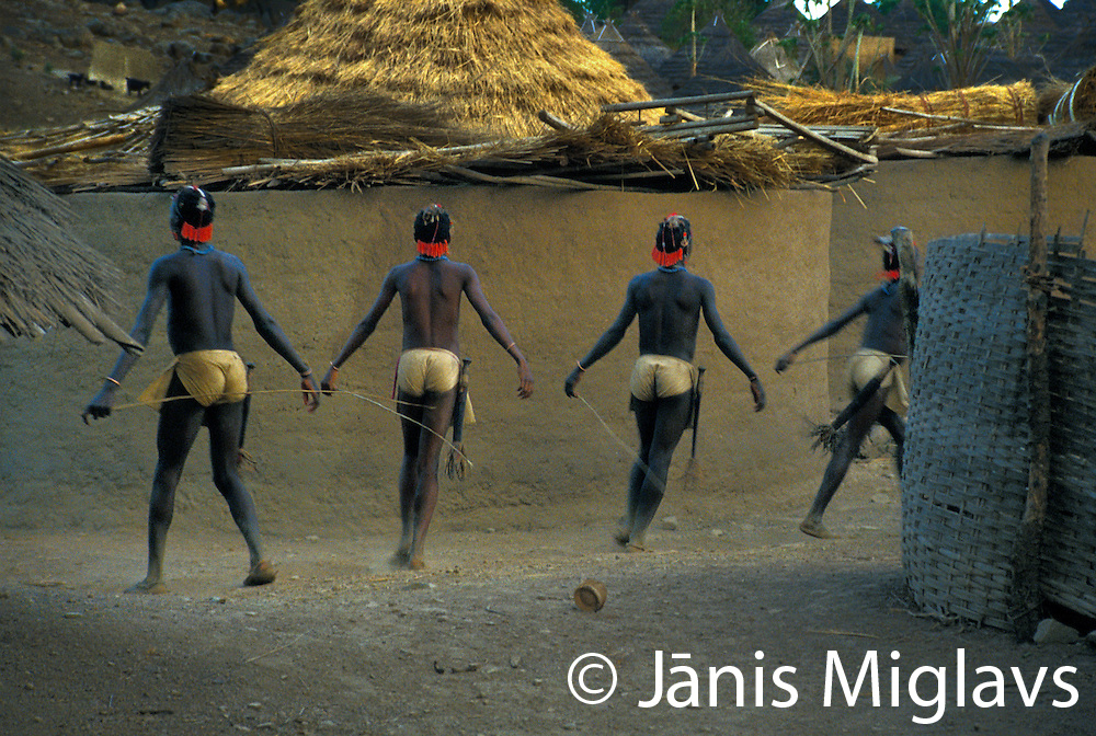 """These 12 and 13-year-old Bedik boys will run like this through their village for one month, then spend another five months in the bush to learn the """"secrets of life."""" Bedik tribe, Senegal, West Africa."""