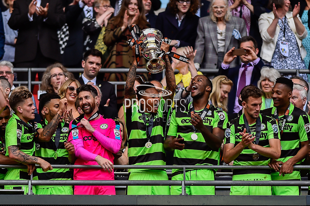 Forest Green Rovers lift the ply off final trophy and celebrate promotion in to the football league Forest Green Rovers Keanu Marsh-Brown(7) during the Vanarama National League Play Off Final match between Tranmere Rovers and Forest Green Rovers at Wembley Stadium, London, England on 14 May 2017. Photo by Adam Rivers.