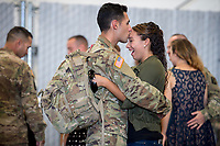 Specialist David Vazquez kisses his girlfriend Victoria Wilkes before the California Army National Guard&rsquo;s 1st Battalion, 184th Infantry Regiment deployment ceremony at the International Jet Center at Sacramento Airport, Saturday Sep 16, 2017. About 300 Soldiers from the California Army National Guard&rsquo;s 1st Battalion, 184th Infantry Regiment, will depart California this weekend for a yearlong training deployment to Jordan in the Middle East. <br /> photo by Brian Baer