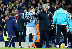 Manchester City Manager, Manuel Pellegrini reorganises his players as Otamendi leaves the pitch witrh an injury  - Mandatory byline: Matt McNulty/JMP - 15/03/2016 - FOOTBALL - Etihad Stadium - Manchester, England - Manchester City v Dynamo Kyiv - Champions League - Round of 16