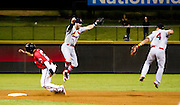 Greg Garcia (7) and Kolten Wong (4) of the Springfield Cardinals leap in the air after game 4 of the Texas League Championship Series against the Frisco RoughRiders at Dr. Pepper BallPark on September 15, 2012 in Frisco, TX.  The Cardinals became the 2012 Texas League Champions after defeating the RoughRiders 2-1.  (David Welker)