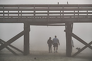 Thick fog blankets Isle of Palms beach a Sea Island near Charleston, South Carolina.