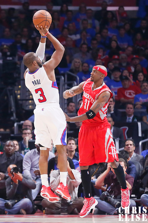 14 May 2015: Los Angeles Clippers guard Chris Paul (3) takes a jump shot over Houston Rockets guard Jason Terry (31) during the Houston Rockets 119-107 victory over the Los Angeles Clippers, in game 6 of the Western Conference semifinals, at the Staples Center, Los Angeles, California, USA.