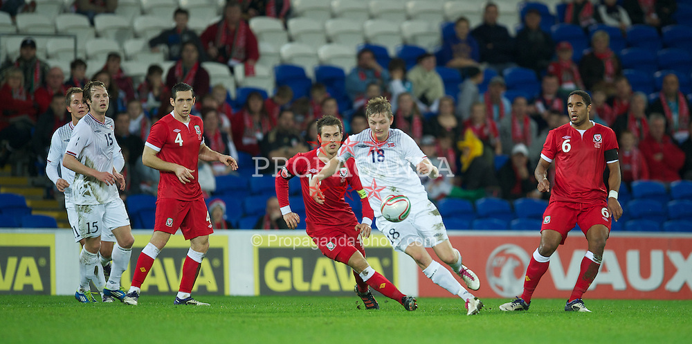 CARDIFF, WALES - Saturday, November 12, 2011: Norway's Erik Huseklepp and Wales' captain Aaron Ramsey during the international friendly match at the Cardiff City Stadium. (Pic by David Rawcliffe/Propaganda)
