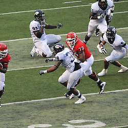 Sep 12, 2009; Piscataway, NJ, USA; Rutgers running back Jourdan Brooks (39) tries to outrun Howard linebacker Jermell Ellis (38) during the second half of Rutgers' 45-7 victory over Howard in NCAA college football at Rutgers Stadium