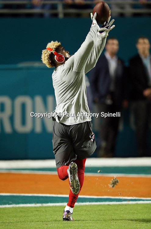 New York Giants wide receiver Odell Beckham Jr. (13) catches an over the shoulder pass while warming up before the NFL week 14 regular season football game against the Miami Dolphins on Monday, Dec. 14, 2015 in Miami Gardens, Fla. The Giants won the game 31-24. (©Paul Anthony Spinelli)