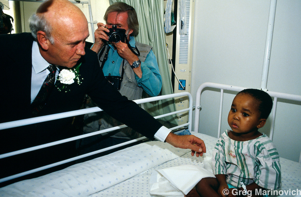 Baragwaneth hospital, Soweto, South frica 1994: President FW de Klerk visits a child in Baragwaneth hospital, Soweto,  in 1994 during the election campaign ahead of South Africa's first non racial elections.