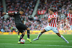 Roberto Firmino of Liverpool is challenged by Marc Muniesa of Stoke City - Mandatory byline: Dougie Allward/JMP - 07966386802 - 09/08/2015 - FOOTBALL - Britannia Stadium -Stoke-On-Trent,England - Stoke City v Liverpool - Barclays Premier League