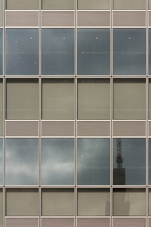 Docomo Tower reflected in the windows of an office building in Shinjuku, Tokyo, Japan. Friday January 19th 2018