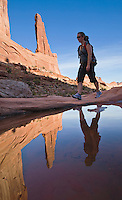 "A woman hiking ""Broadway"" in Arches National Park, Utah, USA."